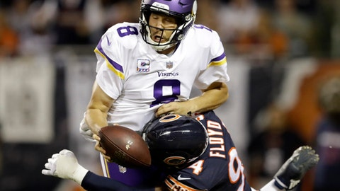 Chicago Bears outside linebacker Leonard Floyd (94) tackles Minnesota Vikings quarterback Sam Bradford (8) for safety during the first half of an NFL football game, Monday, Oct. 9, 2017, in Chicago. (AP Photo/Darron Cummings)