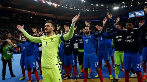 France's goalkeeper HugoLloris, front left, and teammates celebrate after the World Cup Group A qualifying soccer match between France and Belarus at the Stade de France stadium in Saint-Denis, outside Paris, Tuesday, Oct.10, 2017. France won 2-1 to qualify for the 2018 soccer World Cup. (AP Photo/Christophe Ena)