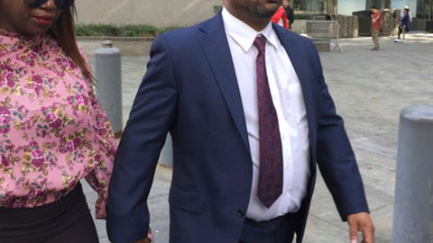 Suspended University of Arizona assistant men's basketball coach, Emanuel Richardson, leaves Manhattan federal court in New York, Tuesday, Oct. 10, 2017, after an initial appearance before a magistrate judge. Richardson will remain free on $100,000 bond. He awaits trial along with three other coaches in a case in which the coaches and others are charged with using hundreds of thousands of dollars in bribes to influence the choices star athletes make about schools, sponsors, agents and financial advisers. (AP Photo/Larry Neumeister)