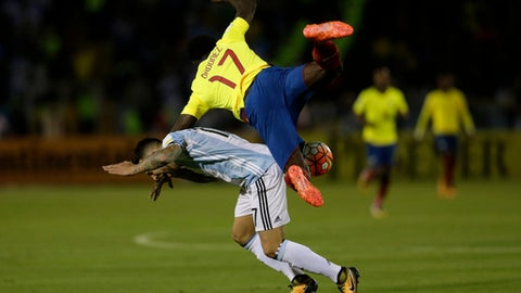 Argentina's Nicolas Otamendi, left, fights for the ball against Ecuador's Roberto Ordonez during their 2018 World Cup qualifying soccer match at the Atahualpa Olympic Stadium in Quito, Ecuador, Tuesday, Oct. 10, 2017. (AP Photo/Dolores Ochoa)