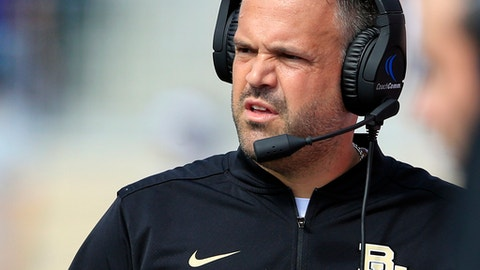 FILE - In this Sept. 30, 2017, file photo, Baylor head coach Matt Rhule watches from the sideline during the first half of an NCAA college football game against Kansas State, in Manhattan, Kan. Rhule wants all those people texting, telling him to hang in there and asking if he's OK, to know that he's doing great. No, he doesn't like that the Bears are still winless. But while having all those young players on the field is hard, that is an  exhilarating part in building a foundation for the future. (AP Photo/Orlin Wagner, File)