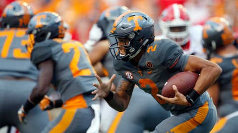 FILE - In this Sept. 30, 2017, file photo, Tennessee quarterback Jarrett Guarantano (2) runs in the second half of an NCAA college football game against Georgia, in Knoxville, Tenn. Tennessee is making a quarterback switch with Jarrett Guarantano taking over for Quinten Dormady as the Volunteers seek to bounce back from their first shutout loss since 1994. Vols coach Butch Jones said Wednesday, Oct. 11, 2017,  that Guarantano would get the starting nod Saturday when Tennessee (3-2, 0-2 SEC) hosts South Carolina (4-2, 2-2). (AP Photo/Wade Payne, File)