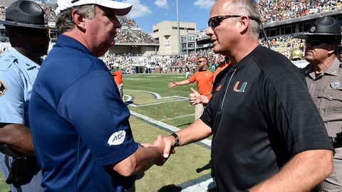 FILE - In this Oct. 1, 2016, file photo, Georgia Tech head coach Paul Johnson, left, speaks with Miami head coach Mark Richt after an NCAA college football game in Atlanta. Georgia Tech's visit to No. 11 Miami headlines the Week 7 schedule in the Atlantic Coast Conference. (AP Photo/Mike Stewart, File)
