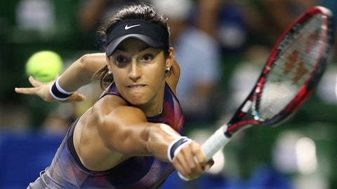 FILE - In this Sept. 22, 2017, file photo, Caroline Garcia, of France, returns a shot to Garbine Muguruza, of Spain, during their quarterfinal match of the Pan Pacific Open tennis tournament, in Tokyo. The WTA says Johanna Konta has withdrawn from the Kremlin Cup next week, meaning Caroline Garcia has secured the eighth and last berth in the WTA Finals. (AP Photo/Koji Sasahara, File)