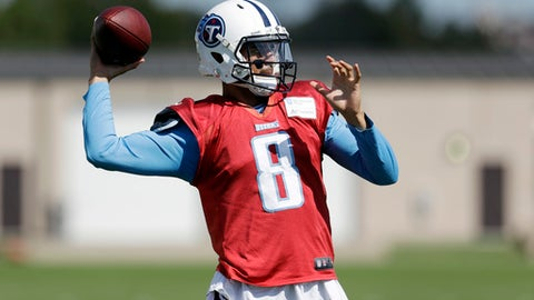 FILE - In this Oct. 4, 2017, file photo, Tennessee Titans quarterback Marcus Mariota throws during NFL football practice in Nashville, Tenn. The Titans are hoping Mariota's hamstring continues improving enough for him to play Monday night against the Indianapolis Colts. (AP Photo/Mark Humphrey, File)