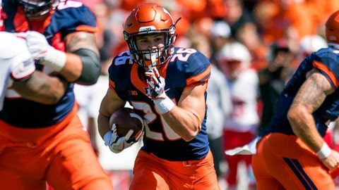 FILE - In this Sept. 2, 2017, file photo, Illinois running back Mike Epstein (26) runs the ball during an NCAA college football game against Ball State at Memorial Stadium in Champaign, Ill. The Illinois offense is ranked last in the Big Ten, but not because of the run game. Illinois piled up 200 rushing yards in a loss at Iowa last weekend, using primarily three running backs to do it. The Illini are hoping to ride the run to a win at home against Rutgers this Saturday. (AP Photo/Bradley Leeb, File)