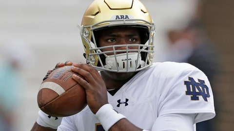 FILE - In this Oct. 7, 2017, file photo, Notre Dame quarterback Brandon Wimbush warms up prior to an NCAA college football game against North Carolina, in Chapel Hill, N.C. Quarterback Brandon Wimbush is slipping and sliding around defenses to compensate for the lack of a passing game, and it's working so far. Josh Adams carries the run game. The Irish are working, and climbing and leaping and grinding, too. But this week, they were forced to add patience to the mix. (AP Photo/Gerry Broome, File)