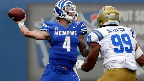 FILE - In this Sept. 16, 2017 file photo, Memphis quarterback Riley Ferguson (4) passes as he is pressured by UCLA defensive lineman Matt Dickerson (99) in an NCAA college football game in Memphis, Tenn. The 25th-ranked Navy Midshipmen are putting a pair of unbeaten streaks on the line in their visit to Memphis. Not only are the Midshipmen (5-0, 3-0 American Athletic Conference) off to a perfect start this season that has put them in the Top 25, Navy has swept Memphis in the first two games of this fledging series. (AP Photo/Mark Humphrey, File)