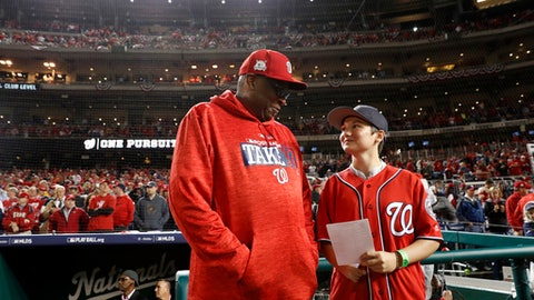 Washington Nationals manager Dusty Baker and Brittany Apgar, 14, of Pleasant Garden, N.C., get ready to deliver the lineup card to home plate umpire Jerry Layne (24) before Game 5 of baseball's National League Division Series against the Washington Nationals, at Nationals Park, Thursday, Oct. 12, 2017, in Washington.  (AP Photo/Alex Brandon)