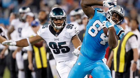 Carolina Panthers' Ed Dickson (84) is knocked out of bounds by Philadelphia Eagles' Mychal Kendricks (95) in the first half of an NFL football game in Charlotte, N.C., Thursday, Oct. 12, 2017. (AP Photo/Bob Leverone)
