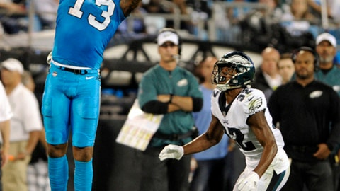 Carolina Panthers' Kelvin Benjamin (13) catches a pass as Philadelphia Eagles' Rasul Douglas (32) defends in the first half of an NFL football game in Charlotte, N.C., Thursday, Oct. 12, 2017. (AP Photo/Mike McCarn)