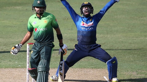 Sri Lanka's wicket keeper appeals as Pakistan's Babar Azam looks on during their first ODI cricket match against Pakistan in Dubai, United Arab Emirates, Friday, Oct. 13, 2017. (AP Photo/Kamran Jebreili)