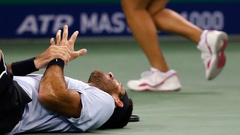 Juan Martin del Potro of Argentina holds his hand in pain after he fell during his men's singles quarterfinals match against Viktor Troicki of Serbia in the Shanghai Masters tennis tournament at Qizhong Forest Sports City Tennis Center in Shanghai, China, Friday, Oct. 13, 2017. (AP Photo/Andy Wong)