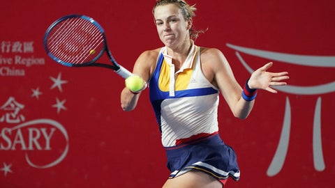Anastasia Pavlyuchenkova of Russia returns a shot to Naomi Osaka of Japan during the quarter-final match at the Hong Kong Open tennis tournament in Hong Kong, Friday, Oct. 13, 2017. (AP Photo/Kin Cheung)