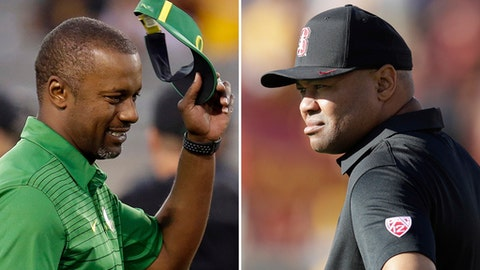 FILE - At left, in a Sept. 23, 2017, file photo, Oregon coach Willie Taggart gestures during an NCAA college football game against Arizona State, in Tempe, Ariz. At right, in a Sept. 9, 2017, file photo, Stanford coach David Shaw watches during warmups before an NCAA college football game against Southern California, in Los Angeles. Shaw and Taggart spent three seasons together at Stanford. Now they prepare to face each other as adversaries when Shaw's 23rd-ranked Cardinal host Taggart's Oregon Ducks. (AP Photo/File)