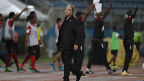 """FILE - In this Oct. 10, 2017, file photo, United States coach Bruce Arena stands on the sideline during a 2018 World Cup qualifying soccer match against Trinidad and Tobago, in Couva, Trinidad. Arena has resigned in the wake of the teams U.S. national team's crash out of contention for the 2018 World Cup. """"We didn't get the job done, and I accept responsibility,"""" Arena said in a statement on Friday, Oct. 13, 2017. (AP Photo/Rebecca Blackwell, File)"""