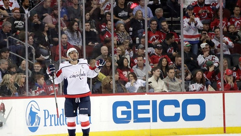 Washington Capitals left wing Alex Ovechkin, of Russia, celebrates his power-play goal against the New Jersey Devils during the second period of an NHL hockey game, Friday, Oct. 13, 2017, in Newark, N.J. (AP Photo/Julio Cortez)