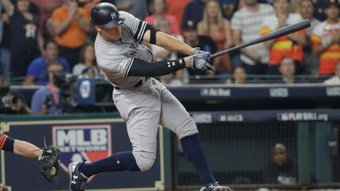 New York Yankees' Aaron Judge strikes out during the third inning of Game 1 of baseball's American League Championship Series against the Houston Astros Friday, Oct. 13, 2017, in Houston. (AP Photo/David J. Phillip)