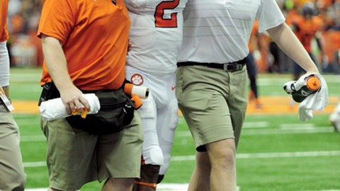 Clemson quarterback Kelly Bryant (2) is helped to the locker room after being injured in the final minute of the first half of an NCAA college football game, Friday, Oct. 13, 2017, in Syracuse, N.Y. (AP Photo/Adrian Kraus)