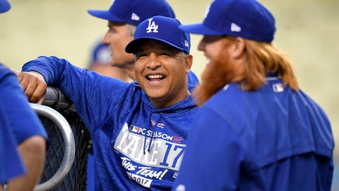 Los Angeles Dodgers manager Dave Roberts, left, talks with third baseman Justin Turner during practice, Friday, Oct. 13, 2017, in Los Angeles in preparation for Game 1 of the National League Championship Series against the Chicago Cubs on Saturday. (AP Photo/Mark J. Terrill)
