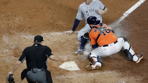 Houston Astros catcher Brian McCann tags out New York Yankees' Greg Bird at home during the fifth inning of Game 1 of baseball's American League Championship Series Friday, Oct. 13, 2017, in Houston. (AP Photo/David J. Phillip)