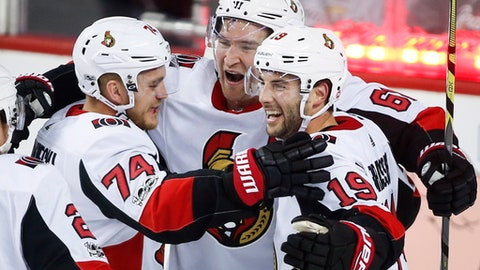 Ottawa Senators' Mark Stone, center, celebrates his goal with teammates during the third period of an NHL hockey game against the Calgary Flames, Friday, Oct. 13, 2017, in Calgary, Alberta. (Jeff McIntosh/The Canadian Press via AP)