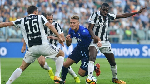 From left, Juventus' Andrea Barzagli, Giorgio Chiellini, Lazio's Ciro Immobile and Juventus' Blaise Matuidi vie for the ball, during the Serie A soccer match between Juventus and Lazio, at the Allianz Stadium in Turin, Italy, Sunday, Oct. 14, 2017. (Andrea Di Marco/ANSA via AP)