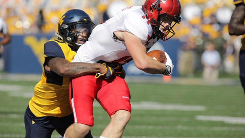 Grier throws for 5 TDs, West Virginia beats Texas Tech 46-35