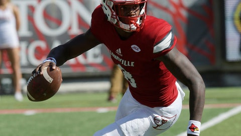 Louisville quarterback Lamar Jackson (8) scrambles as he looks for an open receiver during the second half of an NCAA college football game against Boston College, Saturday, Oct. 14, 2017, in Louisville, Ky. Boston College won 45-42. (AP Photo/Timothy D. Easley)