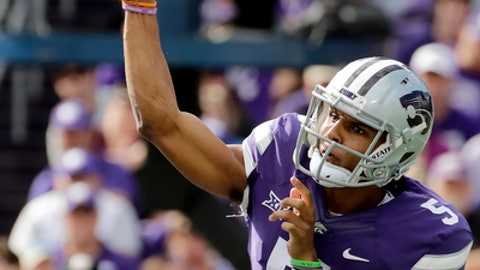Kansas State quarterback Alex Delton (5) throws a pass during the first half of an NCAA college football game against TCU, Saturday, Oct. 14, 2017, in Manhattan, Kan. (AP Photo/Charlie Riedel)
