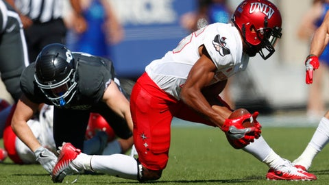 UNLV cornerback Jocquez Khalili, front, picks up a fumble from Air Force running back Nolan Eriksen in the second half of an NCAA college football game, Saturday, Oct. 14, 2017, at Air Force Academy, Colo. Air Force won 34-30. (AP Photo/David Zalubowski)