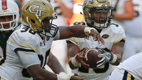 Georgia Tech quarterback TaQuon Marshall, right, fakes a handoff to running back KirVonte Benson (30) during the first half of an NCAA College football game against Miami, Saturday, Oct. 14, 2017 in Miami Gardens, Fla. (AP Photo/Wilfredo Lee)