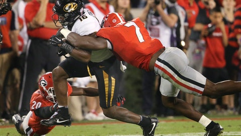 Missouri running back Damarea Crockett (16) is brought down by Georgia linebacker Lorenzo Carter (7) during the first half of an NCAA college football game Saturday, Oct. 14, 2017, in Athens, Ga. (AP Photo/John Bazemore)
