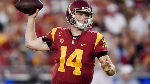Southern California quarterback Sam Darnold passes the ball during the first half of an NCAA college football game against Utah in Los Angeles, Saturday, Oct. 14, 2017. (AP Photo/Kelvin Kuo)