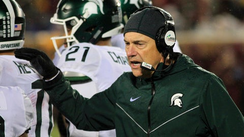 Michigan State head coach Mark Dantonio congratulates players after a touchdown against Minnesota in the first quarter of an NCAA college football game Saturday, Oct. 14, 2017, in Minneapolis. (AP Photo/Andy Clayton-King)