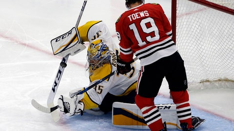 Nashville Predators goalie Pekka Rinne, left, blocks a shot by Chicago Blackhawks center Jonathan Toews during the second period of an NHL hockey game Saturday, Oct. 14, 2017, in Chicago. (AP Photo/Nam Y. Huh)