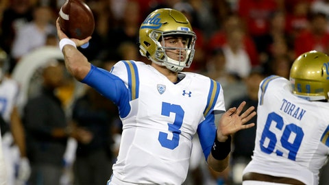 UCLA quarterback Josh Rosen (3) throws down field for a first down against Arizona in the first half during an NCAA college football game, Saturday, Oct. 14, 2017, in Tucson, Ariz. (AP Photo/Rick Scuteri)