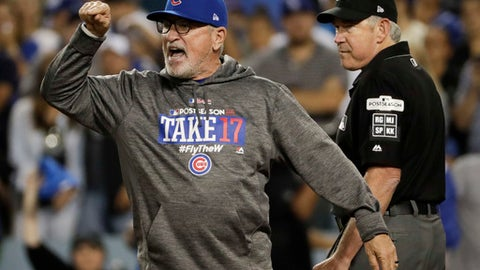 Chicago Cubs manager Joe Maddon, left, argues a call at the plate with umpire Mike Winters, during the seventh inning against the Los Angeles Dodgers in Game 1 of baseball's National League Championship Series in Los Angeles, Saturday, Oct. 14, 2017. (AP Photo/Matt Slocum)