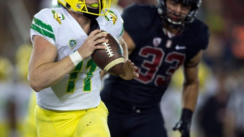 Oregon quarterback Braxton Burmeister (11) scrambles away from pressure by Stanford's Mike Tyler (33) during the first quarter of an NCAA college football game, Saturday, Oct. 14, 2017, in Stanford, Calif. (AP Photo/D. Ross Cameron)
