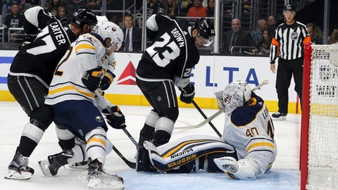 Los Angeles Kings right winger Dustin Brown (23) slips the puck behind Buffalo Sabres Robin Lehner (40) for a goal during the second period of an NHL hockey game in Los Angeles on Saturday, Oct. 14, 2017. (AP Photo/Reed Saxon)