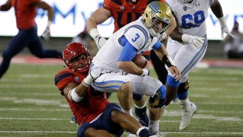 Arizona defensive end Kylan Wilborn sacks UCLA quarterback Josh Rosen (3) during the second half of an NCAA college football game, Saturday, Oct. 14, 2017, in Tucson, Ariz. Arizona defeated UCLA 47-30. (AP Photo/Rick Scuteri)