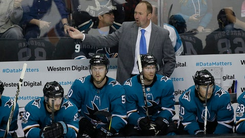 San Jose Sharks coach Peter DeBoer gestures to his players during the third period of an NHL hockey game against the New York Islanders on Saturday, Oct. 14, 2017, in San Jose, Calif. From left are Mikkel Boedker, Chris Tierney, Jannik Hansen, and Tomas Hertl. The Islanders won 3-1. (AP Photo/Eric Risberg)