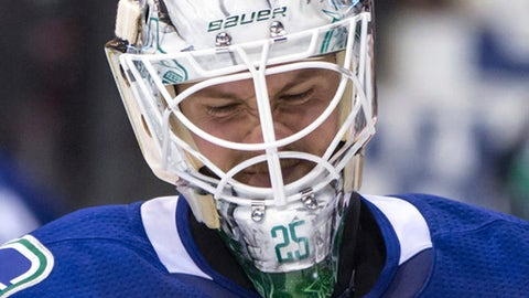 Vancouver Canucks goalie Jacob Markstrom, of Sweden, reacts after making a save against the Calgary Flames during the third period of an NHL hockey game in Vancouver, British Columbia, Saturday, Oct. 14, 2017. (Darryl Dyck/The Canadian Press via AP)