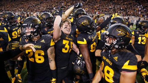 Arizona State players celebrate on the field after an NCAA college football game win against Washington Saturday, Oct. 14, 2017, in Tempe, Ariz. Arizona State defeated Washington 13-7. (AP Photo/Ross D. Franklin)