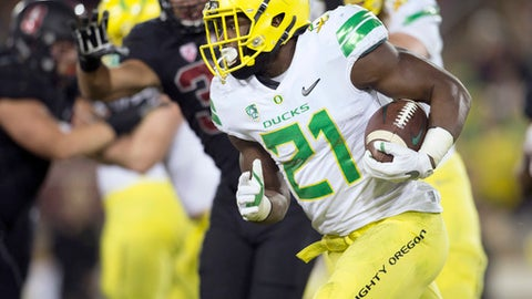 Oregon's Royce Freeman (21) takes the ball around left end against Stanford during the third quarter of an NCAA college football game, Saturday, Oct. 14, 2017, in Stanford, Calif. (AP Photo/D. Ross Cameron)