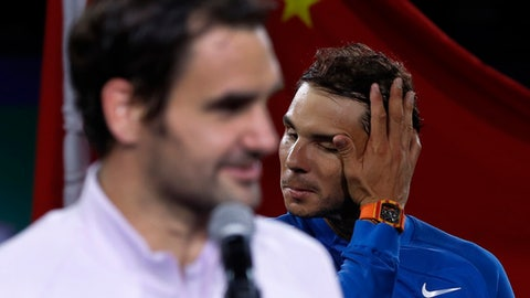 Rafael Nadal, right, of Spain wipes his sweat as Roger Federer of Switzerland speak after losing in their men's singles final match of the Shanghai Masters tennis tournament at Qizhong Forest Sports City Tennis Center in Shanghai, China, Sunday, Oct. 15, 2017. (AP Photo/Andy Wong)
