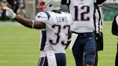 New England Patriots quarterback Tom Brady (12) and Dion Lewis (33) celebrate after a touchdown pass to Rob Gronkowski during the second half of an NFL football game against the New York Jets, Sunday, Oct. 15, 2017, in East Rutherford, N.J. (AP Photo/Seth Wenig)