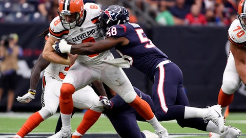Cleveland Browns quarterback Kevin Hogan (8) is sacked by Houston Texans linebacker Lamarr Houston (58) in the second half of an NFL football game, Sunday, Oct. 15, 2017, in Houston. (AP Photo/Eric Christian Smith)