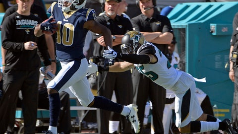 Los Angeles Rams' Pharoh Cooper, left, runs for a touchdown on a kickoff past Jacksonville Jaguars safety Peyton Thompson during the first half of an NFL football game, Sunday, Oct. 15, 2017, in Jacksonville, Fla. (AP Photo/Phelan M. Ebenhack)