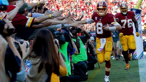 Washington Redskins quarterback Kirk Cousins (8) is greeted by the fans after scoring a touchdown on a quarterback keeper during the second half of an NFL football game against the San Francisco 49ers in Landover, Md., Sunday, Oct. 15, 2017. The Redskins defeated the 49ers 26-24. (AP Photo/Pablo Martinez Monsivais)